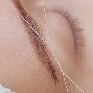 Threading treatments for eyebrows and lips